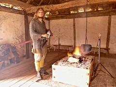 Saxon lord? (Englepip) Tags: museum history saxon character fire hearth hut indoor light cookingpot timberbuilt wattleanddaub sword armour helmet logs