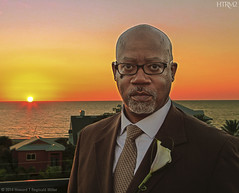 DH, 2014 (HTRM2) Tags: ocean blue sunset portrait orange brown man black male beach water face canon buildings beard gold grey goatee bay lily adult handsome tie suit older africanamerican afroamerican mustache railing hdr highdynamicrange 40s middleage boutonniere middleaged distinguished tonemapped 5d2 5dmkii htrmiller2