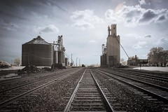 Slater Railroad Tracks Infrared (Notley) Tags: railroad sky usa june clouds america midwest tracks silo missouri infrared grainelevator 2015 10thavenue midamerica notley ruralphotography slatermissouri notleyhawkins missouriphotography httpwwwnotleyhawkinscom notleyhawkinsphotography salinecountymissouri