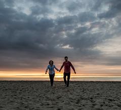 Us (nokkie1) Tags: scheveningen holland beach sunset us man woman sky colours sand lines handinhand running