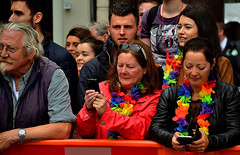 Audience (Owen J Fitzpatrick) Tags: ojf people photography nikon fitzpatrick owen j joe street pavement chasing d3100 ireland editorial use only ojfitzpatrick eire dublin republic city face pride parade woman girl pretty beauty beautiful crowd tamron hair man male tablet phone device necklace rainbow spectrum onlookers leather jacket oconnell spectattors barrier flowers color colour colourful colorful female lean leaning