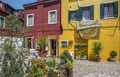 Colorful Burano Houses (Sorin Popovich) Tags: burano venice venetianlagoon venezia veneto buildingexterior buildings builtstructure colourimage colourful red yellow redandyellow orange architecture nopeople urban town italy europe travel traveldestinations tranquility tradition outdoors d810