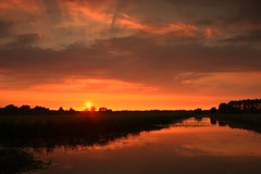 Summertime! (M a u r i c e) Tags: sunset sky sun sunlight water sunshine reflections evening canal cloudy dusk polder efs1022mm