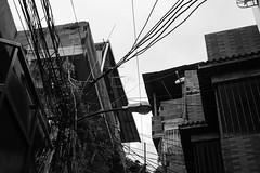 No pagamos luz. (mickeydilesphoto) Tags: blackandwhite cables light power barrio ghetto caracas venezuela latinamerica monocromtico callejn