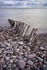 Porlock Harbour Groynes 01 (Photograferry) Tags: exmoor nationalpark uk southwest england outside nopeople landscape nature 2016 porlockwier porlock ocean longexposure groynes pebbles shore sea coast wooden old weathered