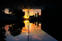 (cara zimmerman) Tags: indianapolis sunset reflection puddle
