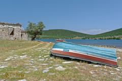 - Sunbathing (dimitrismaggioris) Tags: sea beach water stone boat nikon greece oldhouse seashore nies nikonians magnesia amaliapolis