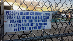 REALLY? (akahawkeyefan) Tags: water sign fence crazy chainlink swimmingpool kingsburg davemeyer