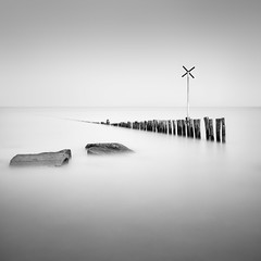 X stands for... (BWUA Photography) Tags: le long exposure black white fine art rocks breakwater timber groyne