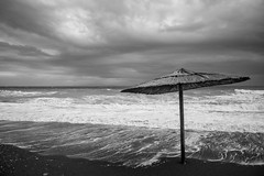 Before the storm (michaelmelachrinidis) Tags: landscape seascape sea windy waves deserted beach beachumbrella clouds moody