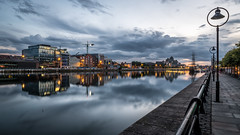 North Wall Quay - Dublin, Ireland - Cityscape photography (Giuseppe Milo (www.pixael.com)) Tags: layered color calm print nature water city background orange trees outside photography sky boat yellow geotagged skyline photo river canvas prints landmark sunset ireland vacation european cityscape view outdoor landscapes outdoors reflection clouds bluesky scenic blue urban scenery fineart travel tranquil peaceful dublin colors photograph horizontal europe depth wallart onsale