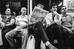 Shoulder Reader (_Codename_) Tags: istanbul turkey blackwhite locals train subway newspaper football