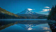 Trillium Lake III (flixology) Tags: morning blue trees sky cloud mountain lake snow mountains color reflection tree nature water hat clouds oregon forest landscape trillium spring mt natural pacific deep panasonic clear national mthood pacificnorthwest layer hood inversion lenticular forests placid lx100