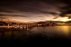 Last Light (Grumpysumpy) Tags: bridge light seascape water clouds bay rocks afternoon dusk sydney australia walkway lastlight bareisland movingwater 1024mm fujixt1