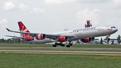 MSP G-VWIN (Skeeter Photo) Tags: minneapolisstpaulinternationalairport msp kmsp chrislundberg virginatlanticairways vir992 airbus a340 a346 a340600 a340642 ladyluck landing avgeek aviation mspairport spotting spotter jfkmsp gvwin