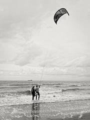 Para sailing (Marc Gommans) Tags: cadzandbad outdoor blackwhite sigma19mmf28dn fastprime marcgommans thenetherlands zwartwit noiretblanc water sea northsea parasailing clouds monochrome blackandwhite
