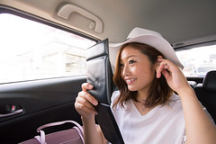 Young woman making up in car (Apricot Cafe) Tags: asianethnicity canonef1635mmf28liiusm japan kanagawa car enjoy happiness indoor nature oneperson strawhat summer transporting traveldestinations vacation weekendactivities woman youngadult zamashi kanagawaken jp img646971