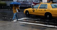 NYC rain (apinedaphotography) Tags: street new york city nyc red rain yellow fiji umbrella photography cab taxi fujifilm x100s