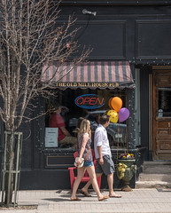 It's Open (Light Collector) Tags: ontario canada tree window balloons awning outside open streetphotography sidewalk millstreet shorts walkers creemore clearviewtownship theoldmillhousepub