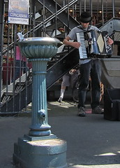 Accordian and Drinking Fountain (D G H) Tags: seattle street people musician music downtown streetphotography sidewalk streetperformer pikeplacemarket busker accordian drinkingfountain pikeplacepublicmarket daveheston