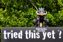 Wally Warthog - Son of Ham (Steve Taylor (Photography)) Tags: sonofsam wally warthog chain collar tusks triedthisyet son ham animal pig art symbol tag sculpture sign advert scary frightening newzealand nz southisland canterbury christchurch cbd city tree leaves sunny sunshine snot