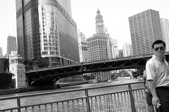 City Askew (Andy Marfia) Tags: street bridge bw chicago river iso200 loop candid 20mm trumptower wrigleybuilding chicagoriver riverwalk fromthehip f63 wabashave 1640sec panasonicgm1