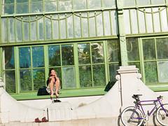 When the sun shines (bernizt) Tags: street light woman house green girl bicycle fence relax iron purple boots candid sunbath sit ra