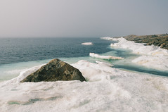 July Sea Ice in Qikiqtarjuaq (JeffAmantea) Tags: nunavut broughton island qikiqtarjuaq ice sea snow ocean rock earth north arctic nikon landcape d90 canada outside explore