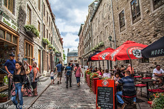 Old Qubec ... (Marty 1955 ...) Tags: canada city quebec street skies people candid clouds martyleclercphotography old caf cobblestone parasol shops bistro