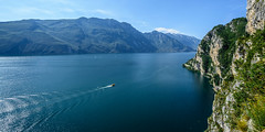 Cruising.... (johngregory250666) Tags: ocean old cruise blue sea summer sky italy cliff lake holiday mountains alps me nature water june rock clouds rural walking landscape coast boat waterfall seaside garda rocks europe waves outdoor formation ridge alpine shore northern dolomites bluff mew