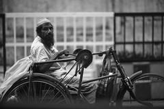 Rasputin's Lament (N A Y E E M) Tags: beggar disabled contraption tricycle candid portrait eid 2ndday eidalfitr street norahmedroad chittagong bangladesh carwindow