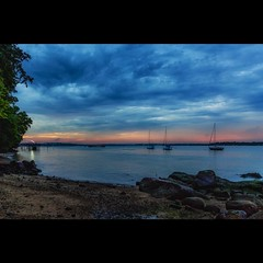 Raining the last few days. Not much of a sunset today... #dawn #sea #beach #sky #cloudy #sunset #boat #boardwalk #kcho67 (: ) :) Tags: evening dawn boat beach sky sea boardwalk changi