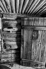Pioneer house, (Barton Cabin) (garylestrangephotography) Tags: brandingiron barton cabin wood log bluff garylestrangephotography utah usa blufffort travelphotography america black white grey monochrome monotone mono indoor inside blackandwhite travel tourism touristlocation touristattraction texture