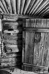 Pioneer house, (Barton Cabin) (garylestrangephotography) Tags: brandingiron barton cabin wood log bluff garylestrangephotography utah usa blufffort travelphotography america black white grey monochrome monotone mono indoor inside blackandwhite travel tourism touristlocation touristattraction texture