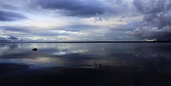 Dark reflections (Joni Mansikka) Tags: nature autumn lake skies clouds calm reflections dark lakescape silhouettes trees horizon stone september landscape outdoor pyhjrvi ylne suomi finland sel1855