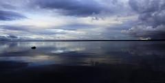 Dark reflections (Joni Mansikka) Tags: nature autumn lake skies clouds calm reflections dark lakescape silhouettes trees horizon stone september landscape outdoor pyhäjärvi yläne suomi finland sel1855