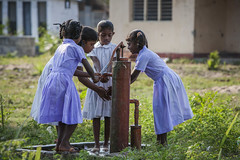 School girls at tubewell 6971 (shahidul001) Tags: child children kid kids girl girls school schoolgirl schoolgirls srilankan srilankans tubewell horizontal color colour srilanka southasia asia drik drikimages