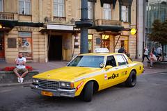 Classic yellow NYC Cab (RafalZych) Tags: d lodz polska poland piotrkowska night nocne photo street by fuji fujifilm x100 nightlife wide classic nyc cab yellow taxi takswka chevrolet chevy caprice parkology