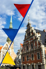 Colored flags on the background of the House of Blackheads (Viktor Descenko) Tags: old city travel blue light red sky urban orange house black color building tower art tourism church beautiful st architecture night facade dark square evening town ancient europe view market flag famous sightseeing landmark baltic latvia celebration peter colored riga blackheads