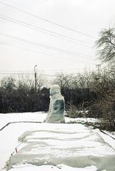 Goodbye Lenin (ijarosek) Tags: park lenin winter white snow cold color film statue 35mm hungary post kodak budapest communist communism bleak plus praktica buda memento postcommunism magyarorszg tl5b postcommunist colorplus colorplus200 prakticatl5b