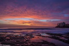 Bathed in colour (Mick Fletoridis) Tags: longexposure seascape water clouds sunrise rocks surf colours sydney australia cronulla