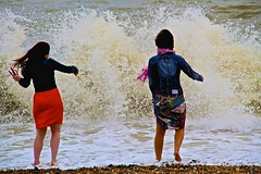 The girls mis-judge their paddle (Neil R Meninick) Tags: england beach seaside funny brighton pebbles shock perfectmoment paddling soaking seaspray crashingwave