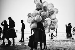 ||The Balloon Seller|| (SouvikMetiaPhotography) Tags: people portrait blackandwhite monochrome morning beach sitting flickr nikon india street streetphotography asia balloon balloonseller contrast documentary
