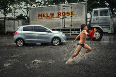 Tondo, Manila - The freedom of having nothing (Mio Cade) Tags: rain monsoon flood traffic freedom fun play run child boy kid thunderstorm thunder manila philippines tondo streetphotography street reportage documentary splash