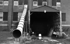 Black Holes (Neal3K) Tags: illinois redmonillinois bw blackandwhite blackholes abandonedschool fireescape escapeslide