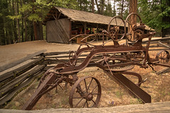 Lots of wheels and levers (HewesViews) Tags: history antique sony yosemite yosemitenationalpark hdr oldequipment photomatix pioneeryosemitehistorycenter sonya77ii tamron16300