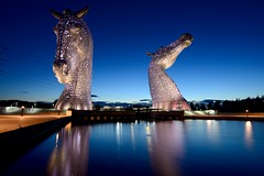 The Kelpies in the blue hour (iancowe) Tags: kelpies thekelpies falkirk helix park statue scotland floodlit evening clydesdale horses canal reflection scottish pool gloaming