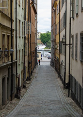 """Pathway to the Light"" (Gamla Stan, Stockholm) (CJPhotography UK) Tags: urban building alley street city cityscape architecture manmade sweden stockholm gamlastan old town windows house houses walk path people human man light shade summer shadow dark lighting sun sunlight lines linear symmetry parallel"