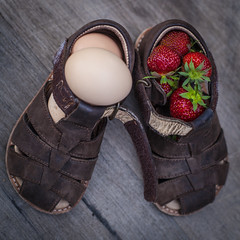 Strange combination (' A r t ') Tags: arthurcammelbeeck cammelbeeck denmark outdoor raw artcammelbeeck camelendk carry eggs shoe shoes strangecombination strawberries strawberry wwwflickrcomphotosartcammelbeeck