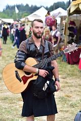 Medieval Guitar (RichSeattle) Tags: richseattle nikon d750 summer enumclaw seattle washington washingtonstate costumes renaissancefair renaissance man guy guitar kilt